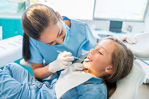 Child in dental chair getting orthodontic exam