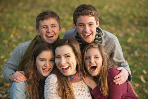 A group of smiling teenagers with braces from Senestraro Family Orthodontics in Portland OR